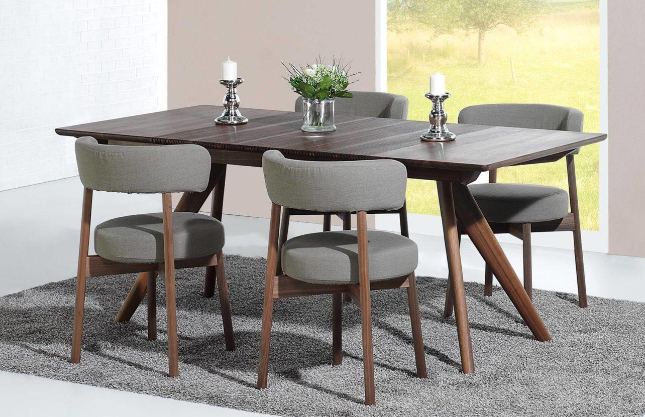 Stühle Lignum Arts S-01 in Nussbaum mit Sitz- und Rückenpolster in Stoffausführung. Tisch Lignum Arts T07